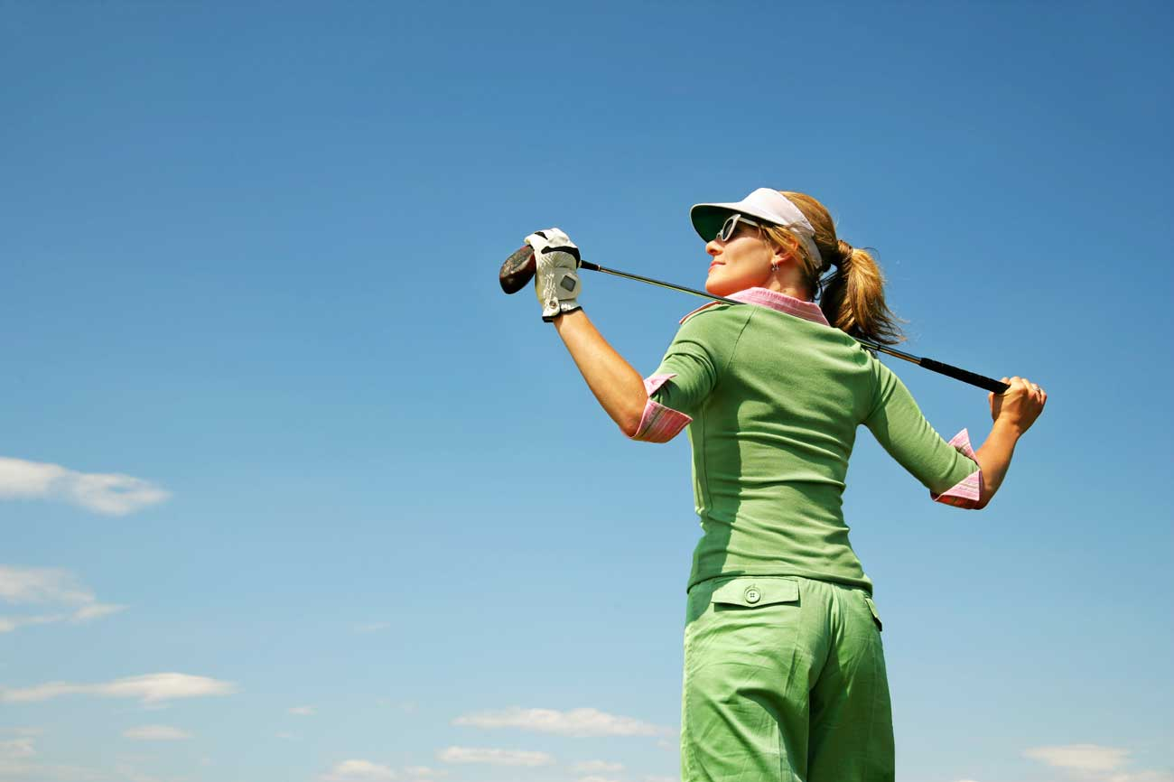 Female-Golfer-with-club-behind-her-head